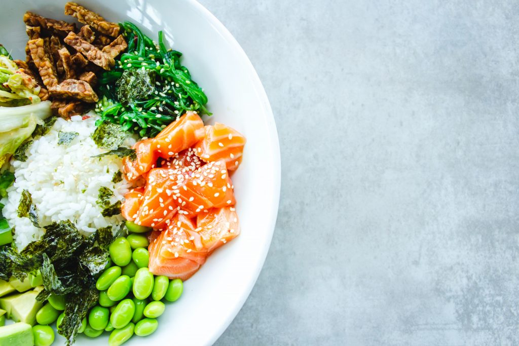 salmon on white plate with vegetables