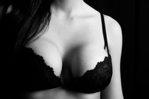 enlarged breast in the black bra
