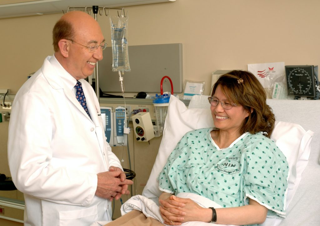 doctor laughing with the patient