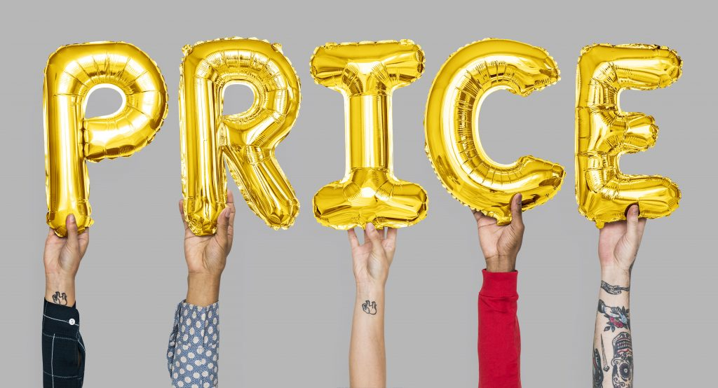 Hands holding price word in balloon letters