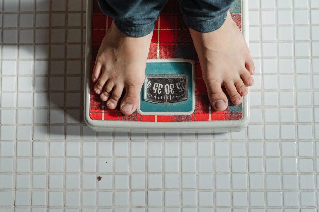 Person weighing on scale
