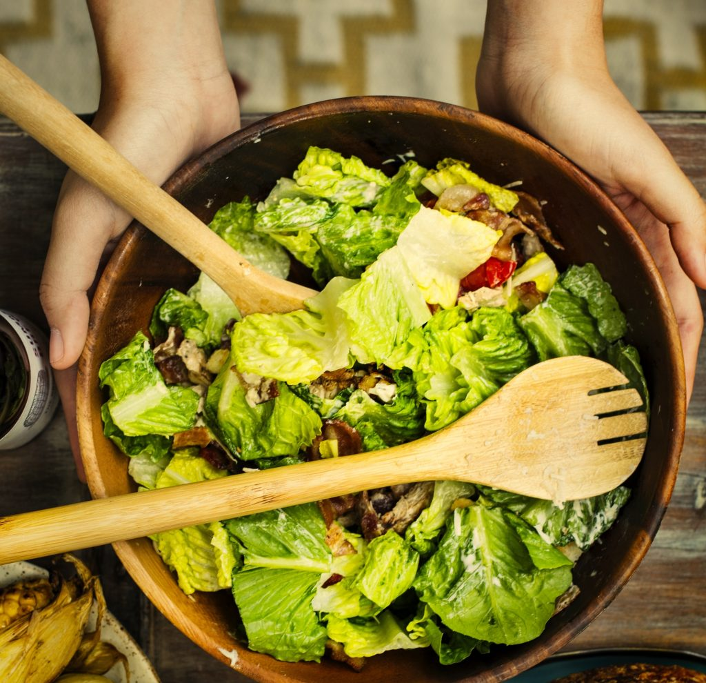 Woman holding a healthy salad