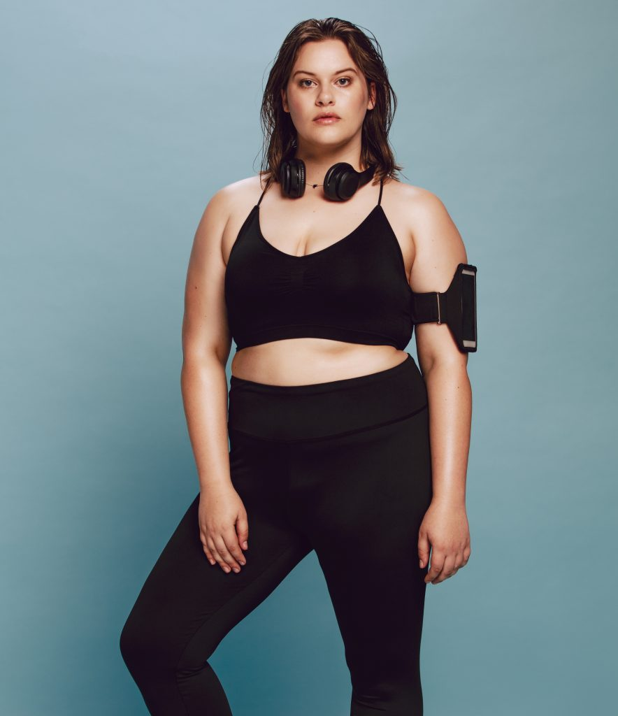 Chubby woman in sports clothing