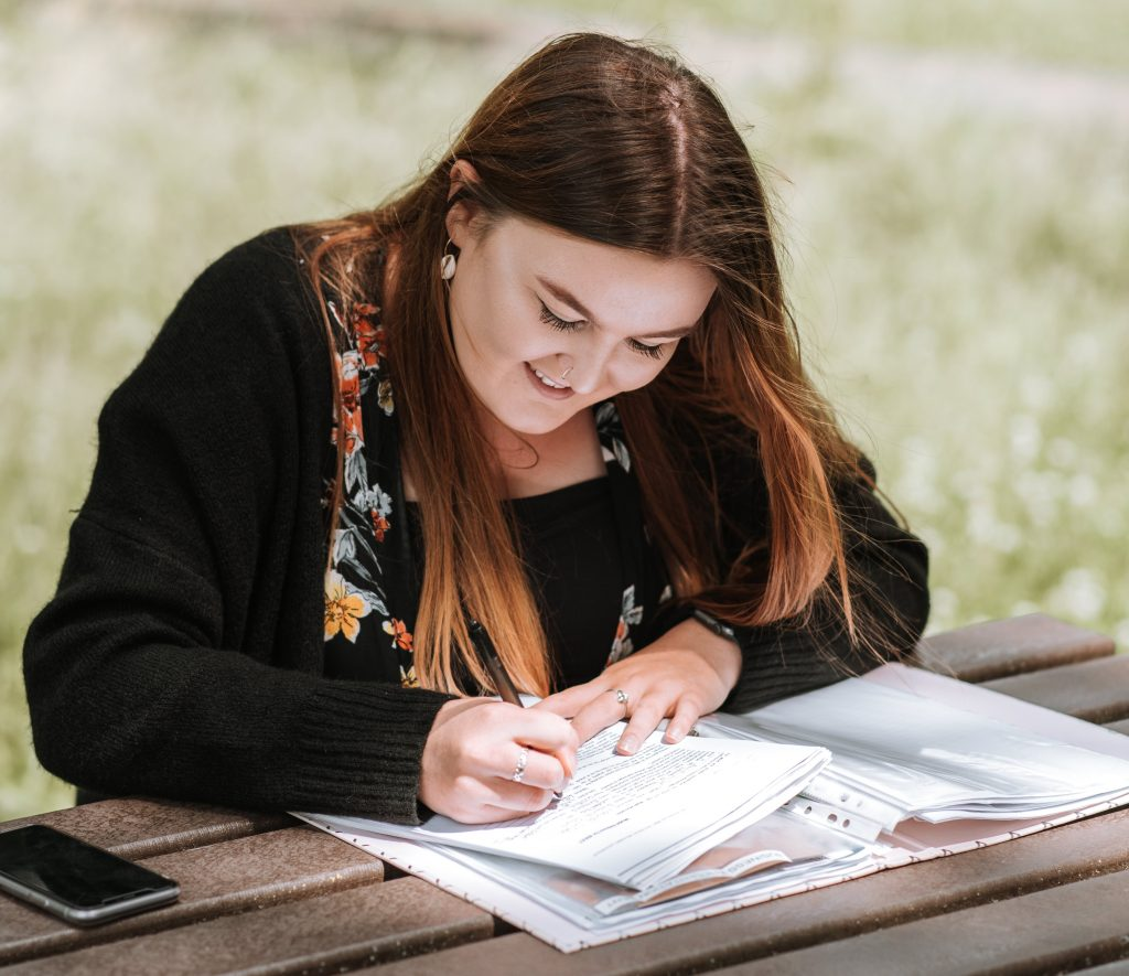 lasy writing and smiling